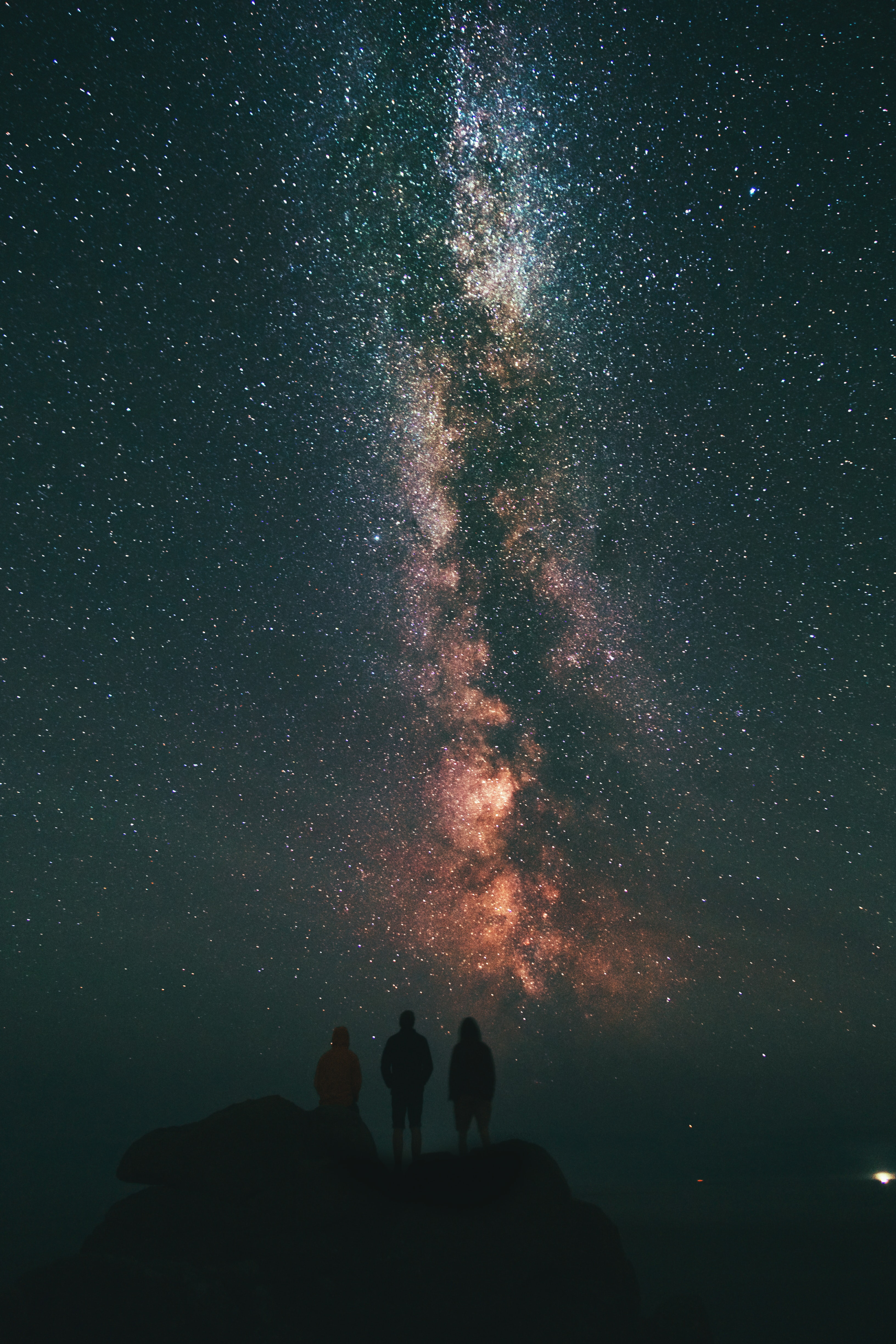 Image of 3 people looking at stars