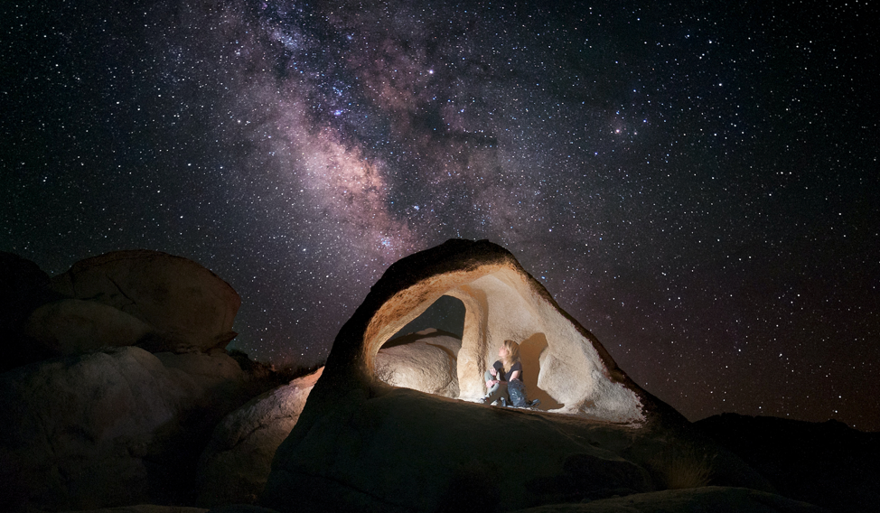 Image of woman looking at the Milky Way