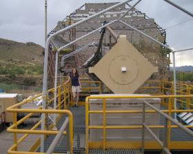 Sarah in front of a Cherenkov Telescope