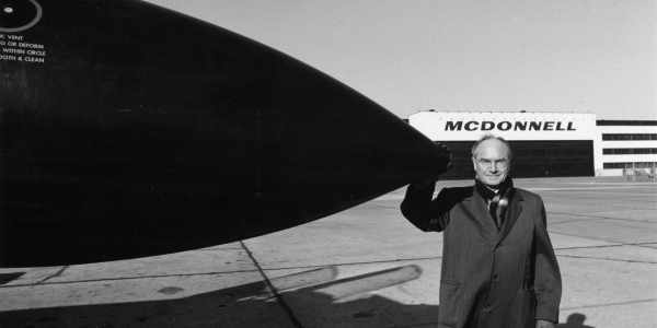 James McDonnell with nose of airplane