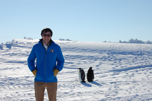 Quin Abarr in Antarctica with penguins